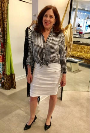Pattie trying on gingham top and skirt.jpg