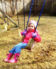 Rosalie swinging.JPG