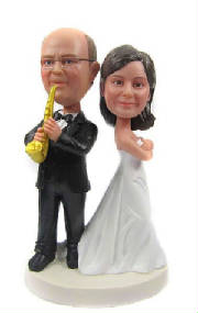 Wedding cake topper with sax-playing groom.jpg