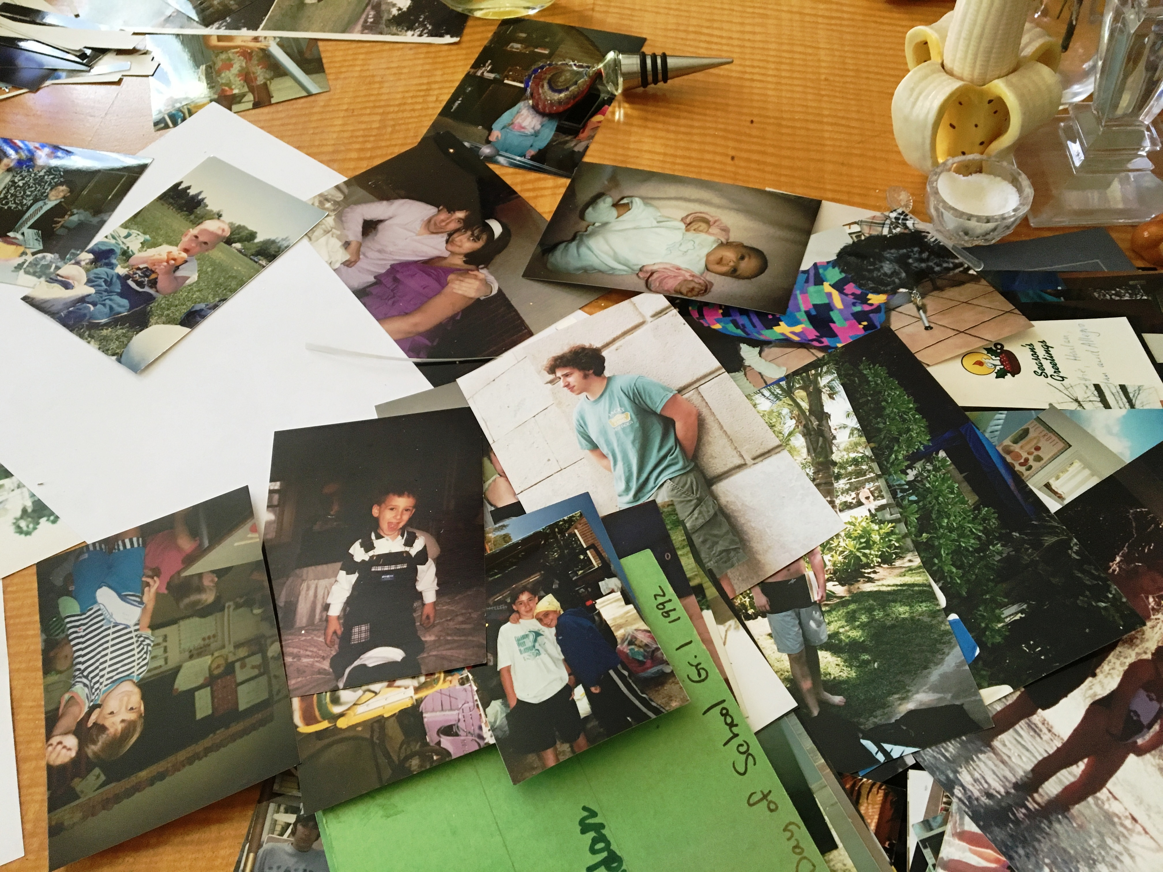 Photos covered the dining room table.JPG