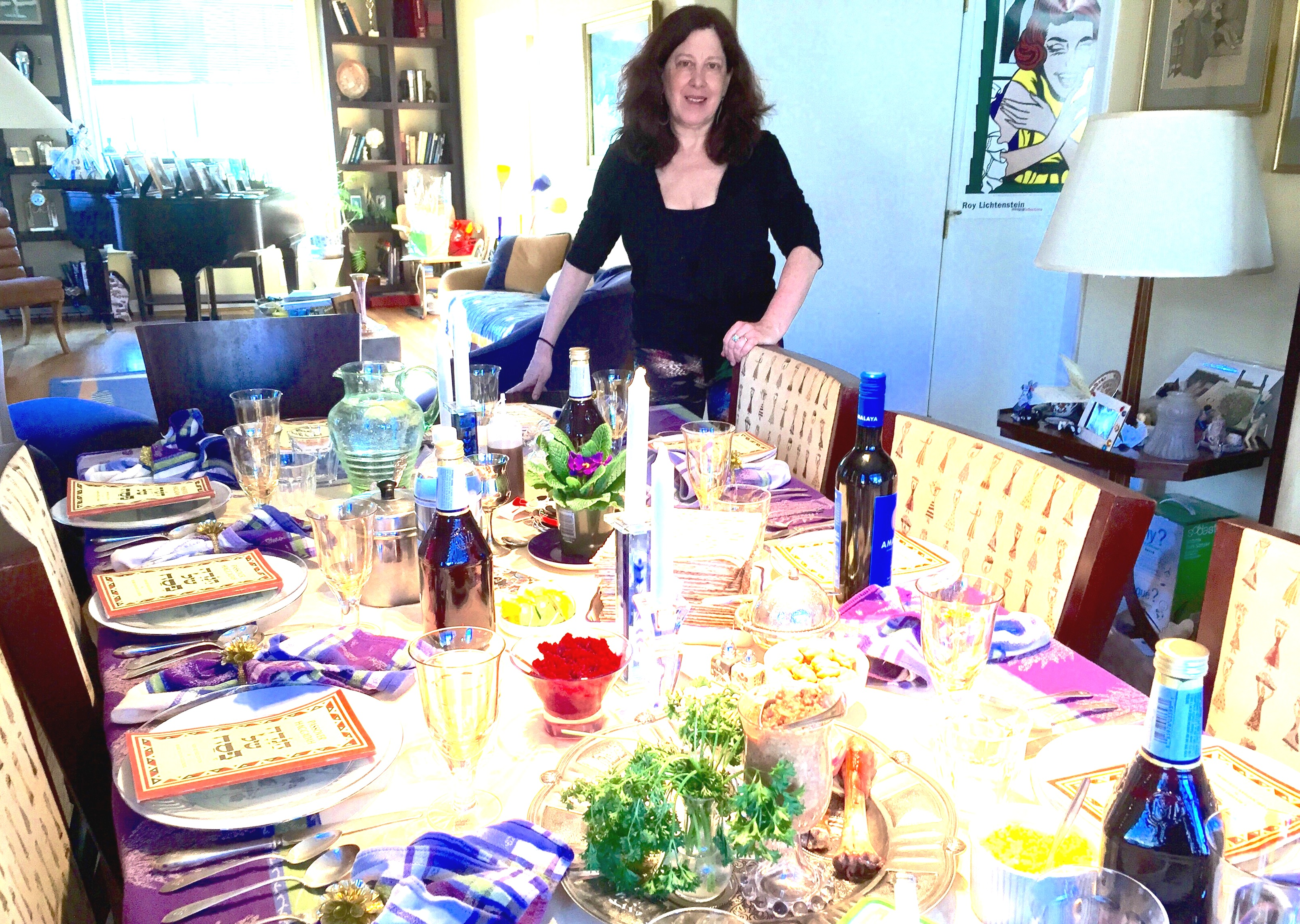 Pattie with Passover table.JPG